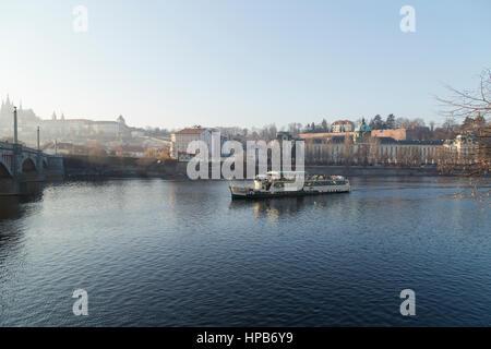 Tourists enjoying a pleasure cruise along river Vltava in Prague Czech Republic - Stock Photo