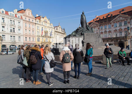 Tourists in front of the Jan Hus Memorial in Old Town Square in Prague Czech Republic - Stock Photo