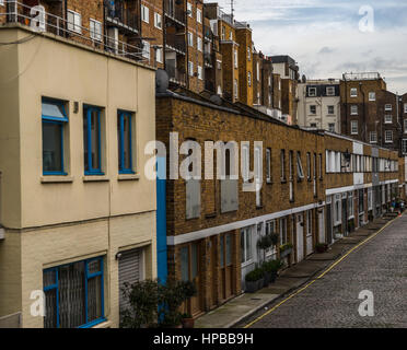 View on an interesting  street, characteristic buildings English quarter, the combination of low and high-rise buildings, - Stock Photo