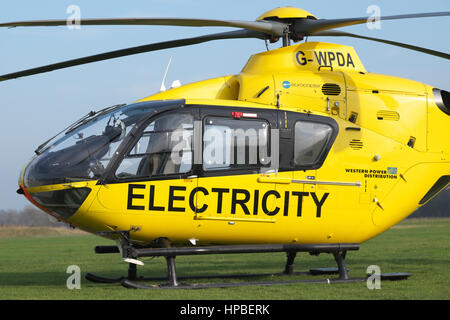 Eurocopter EC 135 helicopter used for electricity power supply checking by Western Power Distribution WPD in UK - Stock Photo