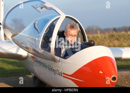 Glider pilot prepares himself for a glider flight at Herefordshire Gliding Club UK in a Grob G103 Twin Acro glider - Stock Photo
