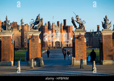 Hampton Court Palace: Main Entrance gate with gate posts and drive leading to the Central Gatehouse, West Front, - Stock Photo