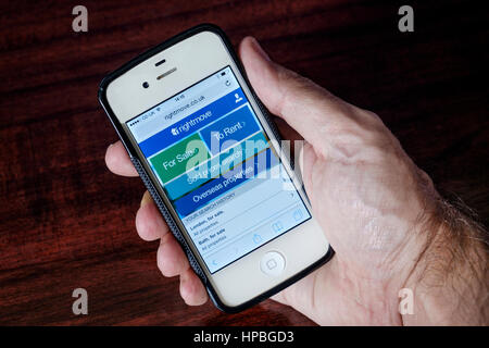 The online property website Rightmove is pictured being viewed on a iphone mobile phone. - Stock Photo