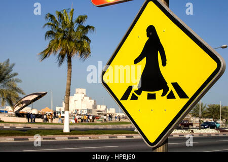 Qatar Doha arabian sign for crosswalk at the al corniche street , in the background  Museum of islamic art and the - Stock Photo