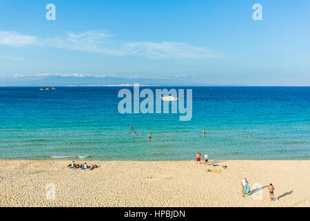 The beach of Rena BIanca at Santa Teresa Gallura, Sardinia Italy with the coast of Corsica Island in the background - Stock Photo