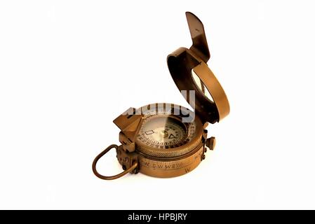Old magnetic copper compass with light reflections on  glass cover isolated on white background - Stock Photo