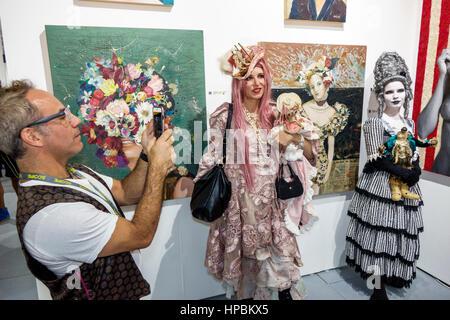 Miami Beach Florida Art Basel Week satellite art fair Scope Art contemporary art performance art man woman costume - Stock Photo