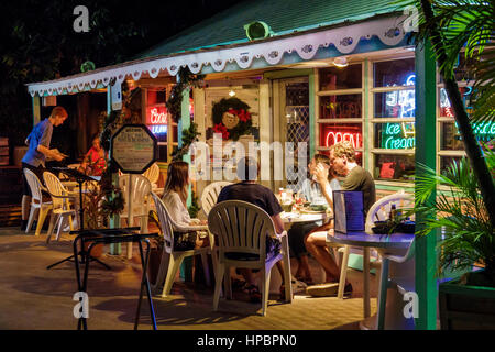 Key Largo Florida Upper Florida Keys Mrs. Mac's Kitchen restaurant seafood dining alfresco table porch man woman - Stock Photo