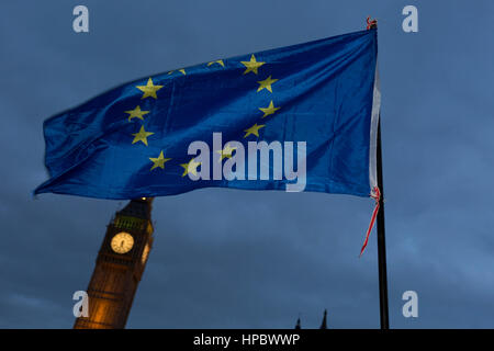 London, 20th February 2017: An EU flag is waved in front of the British parliament as the British government debated - Stock Photo