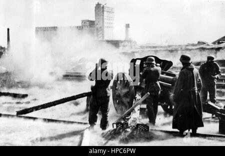 The Nazi propaganda image shows German Wehrmacht artillery in use in battle at the rail-yard at the Southern Train - Stock Photo