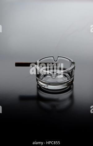 Osterode, Germany. 21st Feb, 2017. ILLUSTRATION - A cigarette in an ashtray, Germany, city of Osterode, 21. February - Stock Photo