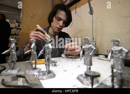 St Petersburg, Russia. 21st Feb, 2017. Polishing tin soldiers at the Niena Studio. The studio specialises in manufacturing - Stock Photo