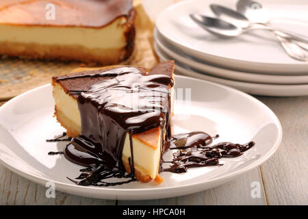 Cheesecake slice with melted chocolate - Stock Photo