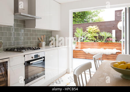 Contemporary kitchen with stylish white units - Stock Photo