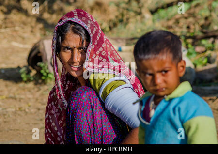 RAJASTHAN, INDIA - NOVEMBER 20, 2016: Rajasthani poor woman wearing sari and traditional ornaments on her hands, - Stock Photo