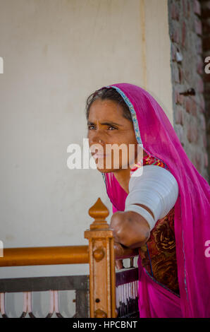 RAJASTHAN, INDIA - NOVEMBER 20, 2016: Unidentified elderly Rajasthani woman waiting for someone wearing traditional - Stock Photo