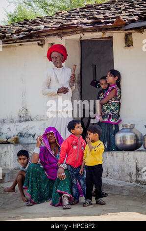 RAJASTHAN, INDIA - NOVEMBER 20, 2016: Five young grandchildren with their elderly grandparents when their parent - Stock Photo