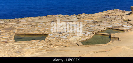 The saltpans are still in use - Stock Photo