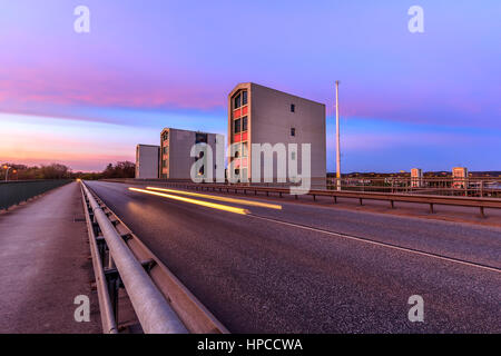 Lights of a car in front of the dam - Stock Photo