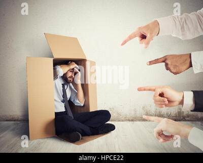 Guilty businessman indicated by colleagues - Stock Photo