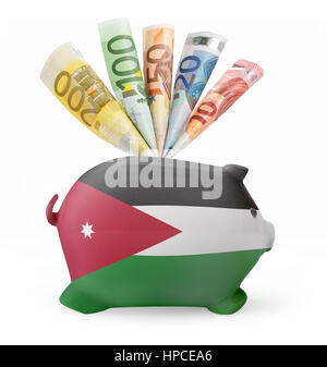 Side view of a piggy bank with the flag design of Jordan and various european banknotes.(series) - Stock Photo