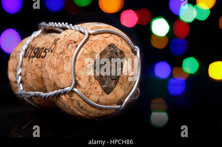 Champagne cork with the shape of Swaziland burnt in and colorful blurry lights in the background.(series) - Stock Photo
