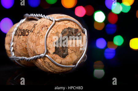 Champagne cork with the shape of Western Sahara burnt in and colorful blurry lights in the background.(series) - Stock Photo