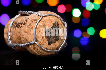 Champagne cork with the shape of Western Australia burnt in and colorful blurry lights in the background.(series) - Stock Photo