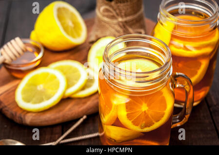 Hot tea with lemon and honey, good treat to have vitamins and strong immunity. - Stock Photo