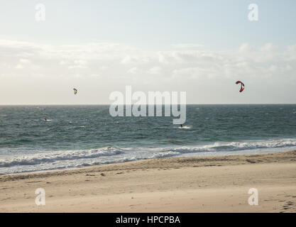 Two men kitesurfing on the beach in Indian ocean in Perth, Western Australia - Stock Photo
