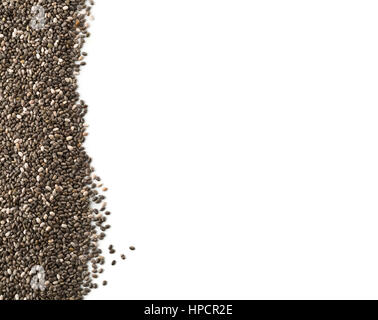 Raw unprocessed whole dried black chia seed border on white background - Stock Photo