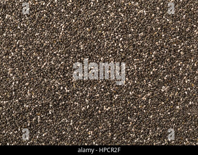 Raw, unprocessed, dried black chia seeds frame filling texture background - Stock Photo