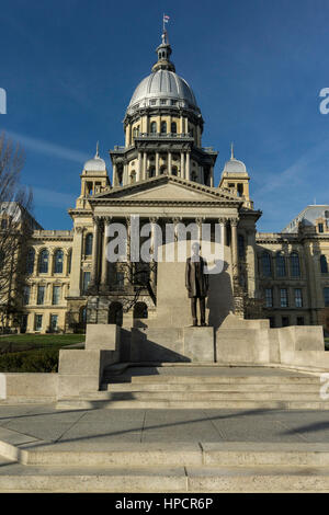 Statue of Abraham Lincoln in front of Illinois state capital. - Stock Photo