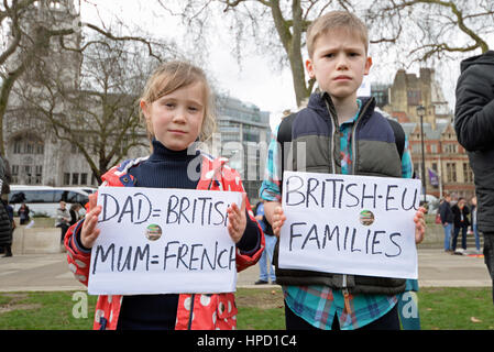 Children holding placards opposing Brexit pro EU during a protest rally on Parliament Square, London, UK. Child. - Stock Photo