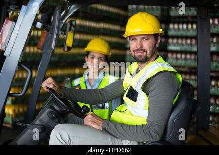 Portrait of smiling factory workers in factory - Stock Photo