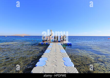 Red sea, coral and plastic pontoon in Sharm El Sheikh resort - Stock Photo