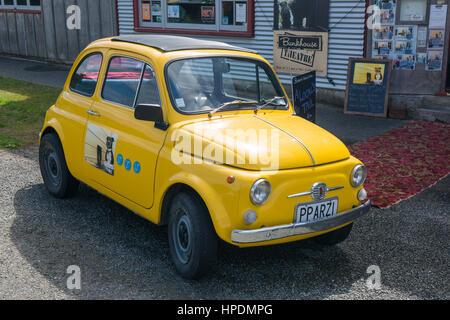 Oban, Stewart Island, Southland, New Zealand. Eye-catching Fiat 500 outside the Bunkhouse Theatre. - Stock Photo