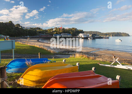 Oban, Stewart Island, Southland, New Zealand. Colourful upturned boats on the shore of Halfmoon Bay. - Stock Photo