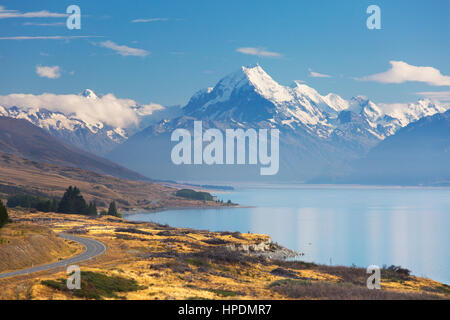 Twizel, Canterbury, New Zealand. View from Peters Lookout along tranquil Lake Pukaki to the snow-capped summit of Aoraki/Mount Cook.