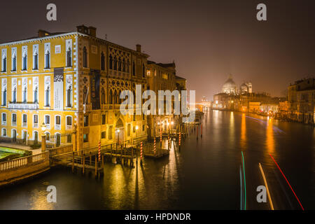 The view from the Ponte Dell'Accademia bridge at night. In the distance can be seen the Basilica di Santa Maria - Stock Photo