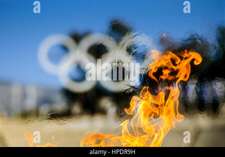 Olympic fire in front of the Panathenaic Stadium,  Athens, Greece, Europe - Stock Photo