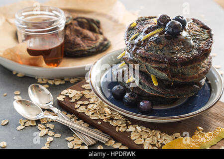 Healthy pancakes - oat, blueberries and lemon zeist - Stock Photo