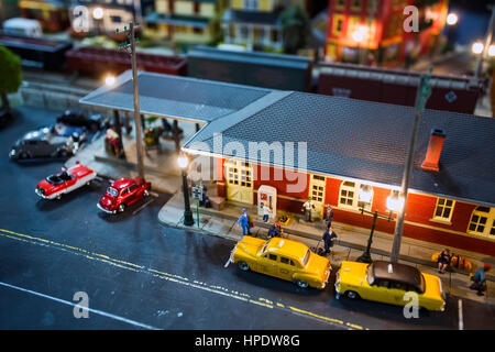 A shallow depth-of-field shot of a detailed miniature train station set. - Stock Photo