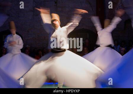 Drevish mystic dance at Hodjapasha Culture Center, Meulevi sema ceremony.Hokapasa Hamami Sk Nº5-9d,  . Istanbul. - Stock Photo