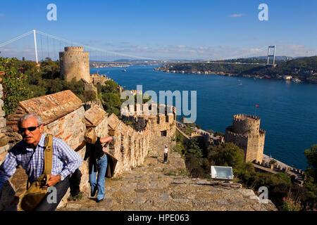Rumeli Hisari fortress and Fatih Sultan Mehmet Bridge, Bosphorus Strait, Istanbul, Turkey - Stock Photo