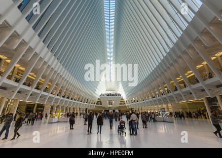 Shoppers and tourists enjoy the view inside the Oculus and stores in the Westfield World Trade Center mall in New - Stock Photo