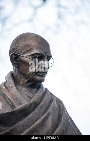 Mahatma Gandhi statue in Parliament Square, opposite the Palace of Westminster, London, UK. Bronze by Philip Jackson. - Stock Photo