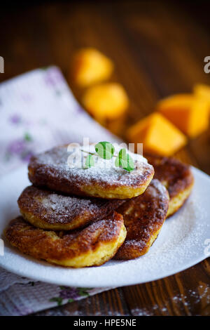 Sweet pumpkin pancake on a dark wooden table - Stock Photo