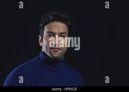 Portrait of a smiling man wearing blue colour polo neck t-shirt - Stock Photo