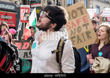 Protesters carrying placards and signs are pictured as they take part in a protest in Bristol in support of striking - Stock Photo